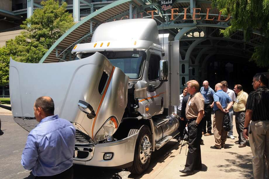 Business partners and potential customers view natural gas-powerd Ryder Trucks at Minute Maid Park Tuesday June 04, 2013. Photo: Dave Rossman, For The Houston Chronicle