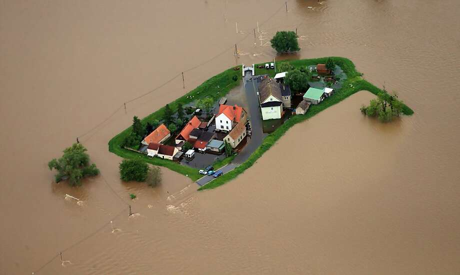 More like Islandburg:The rising waters of the River Mulde surround a cluster of homes in Eilenburg, Germany. Photo: Jens Wolf, AFP/Getty Images