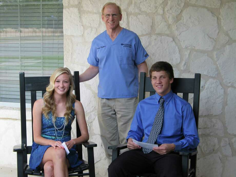 Dr. Mark Penshorn, center, presents Penshorn Dentistry Excellence in Science scholarships to Emily Helgren of Steele High School (left) and Zachary Goodall of Clemens High School. Helgren and Goodall each received a $1,250 scholarship grant. Photo: Courtesy Photo