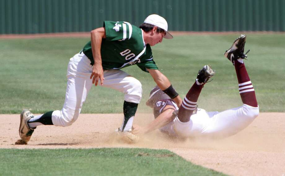 Marion shortstop Scottie Brown tags out a Hallettsville player at second base Saturday during the Bulldogs 5-4 loss in game two of the Class 2A regional finals. Hallettsville swept Marion in two games in the best-of-three series and advanced to the state tournament. Photo: Greg Bell / For The NE Herald
