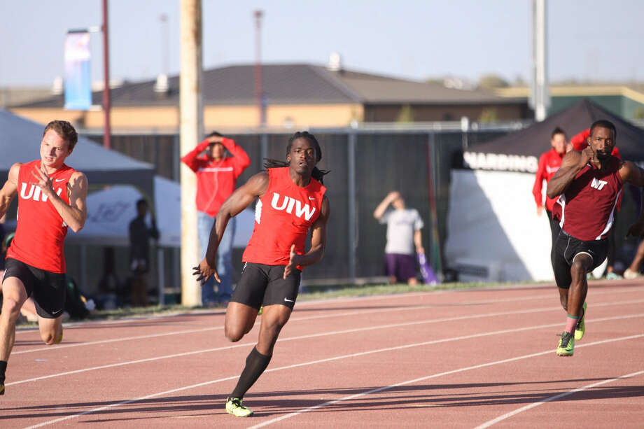 UIW sprinter Tommy Brown, center, won the 200-meter dash at the Lone Star Conference track and field meet May 4 in Canyon, Texas. The Steele High School alumnus also helped UIW's 400 relay team to a gold and finished second in the 100. Photo: Jeremy Singleton / Courtesy Photo