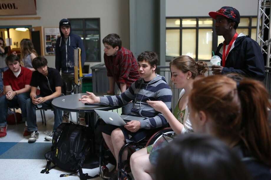 Zak Meyer (seated), Yasab Pfister (standing) and other Center School students plan campaign to retain popular teacher Jon Greenberg. Greenberg, who teaches a race-and-social-justice curriculum, gained attention of school officials after the family of one student complained about the curriculum. The majority of the school's students supported the teacher after the district sought to censor the course. Photo: JOSHUA TRUJILLO, SEATTLEPI.COM