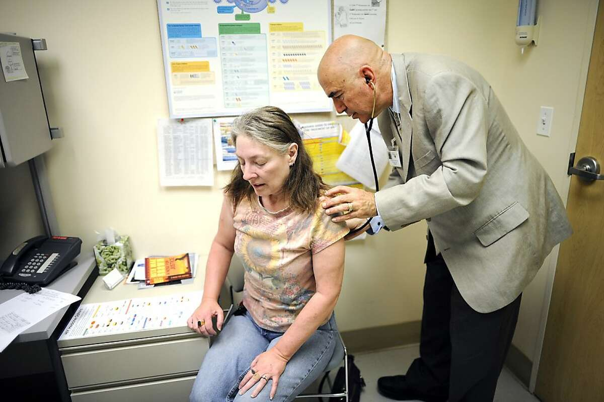 Jenelle Prins(L) of Emeryville, who suffers chronic pain due to spinal injuries incurred in a car accident and later an airplane accident, is examined by Dr. Kornfeld during a check up visit in the pain clinic at Highland General Hospital in Oakland, CA on Tuesday May 28th, 2013.