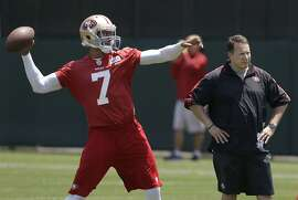 San Francisco 49ers offensive consultant Eric Mangini, right, watches as quarterback Colin Kaepernick (7) practices at the NFL football team's training camp in Santa Clara, Calif., Tuesday, June 4, 2013. (AP Photo/Jeff Chiu)