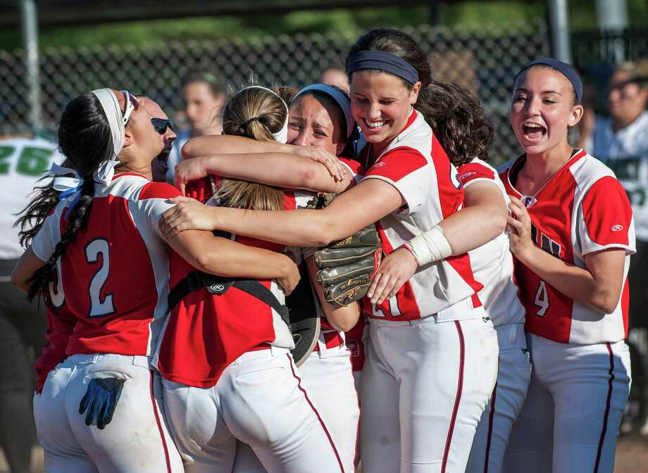 The Foran high school softball team celebrate their win against Maloney high school in a CIAC class L semifinal softball game played at West Haven high school, West Haven, CT on Tuesday June 4th, 2013. Photo: Mark Conrad / Connecticut Post Freelance