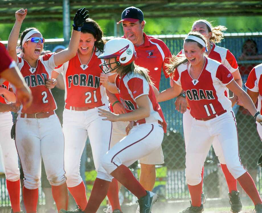 Foran high school teammates and coach Jeff Bevino cheer Dani Kemp as she touches home base after hitting an in the park home run during a CIAC class L semifinal softball game against Maloney high school played at West Haven high school, West Haven, CT on Tuesday June 4th, 2013. Photo: Mark Conrad / Connecticut Post Freelance