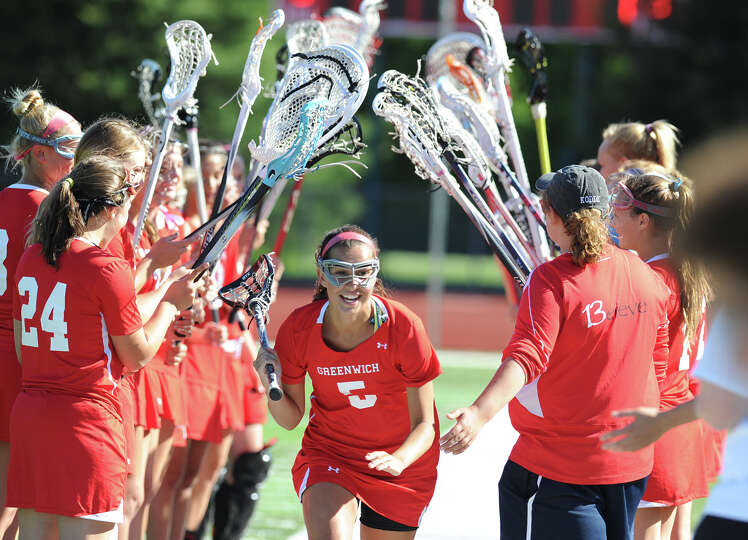 At center, Emma Christie of Greenwich during the start of the Class L girls lacrosse semifinal match