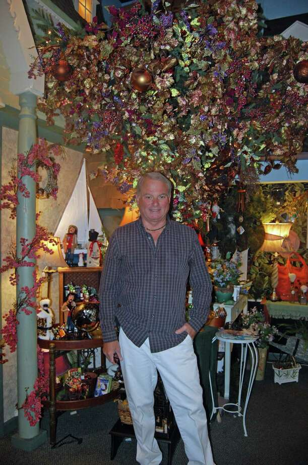 John Deorio stands amidst the gifts in Sassafras, which he will close June 30 after 29 years on Washington St. in South Norwalk. Photo: N