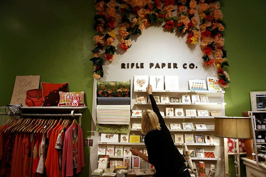 Nicole Bald, an employee at Lavish, rearranges a display of stationery at the store's Hayes Street location. Photo: Katie Meek, The Chronicle