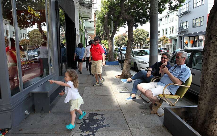 Selene Goksel, 2, is drawn to a shop window in Hayes Valley, which currently bans chain retailers. Photo: Lance Iversen, The Chronicle