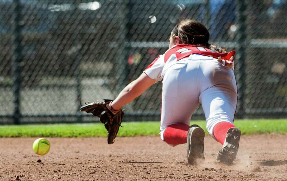 Foran high school shortstop Marissa Bruno dives for a ground ball during a CIAC class L semifinal softball game against Maloney high school played at West Haven high school, West Haven, CT on Tuesday June 4th, 2013. Photo: Mark Conrad / Connecticut Post Freelance