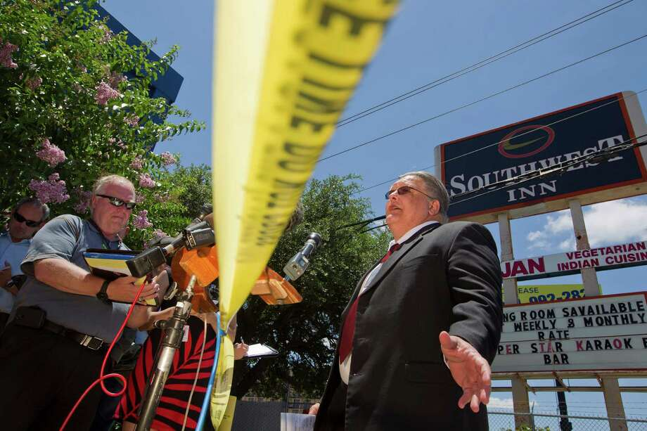 Ed Arthur, deputy chief of Houston Fire Department's Arson Division, speaks to the media at the scene of the restaurant and hotel fire where four firefighters died on the 5800 block of the Southwest Freeway Tuesday, June 4, 2013, in Houston. Photo: Johnny Hanson, Houston Chronicle / © 2013  Houston Chronicle