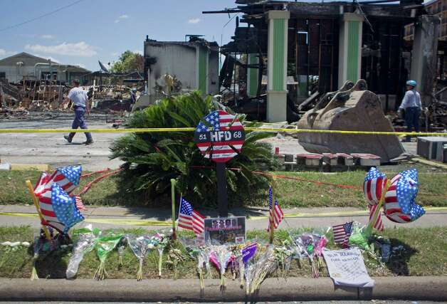 A memorial is left at the scene where the four firefighters died as ATF agents, fire marshals and investigators continued to go through the burnt remains of the Southwest Inn and the Bhojan Indian restaurant on the 5800 block of the Southwest Freeway Tuesday, June 4, 2013, in Houston. Photo: Johnny Hanson, Houston Chronicle / © 2013  Houston Chronicle