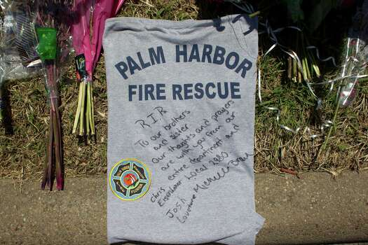 A T-shirt with a message is left at the scene where the four firefighters died as ATF agents, fire marshals and investigators continued to go through the burnt remains of the Southwest Inn and the Bhojan Indian restaurant on the 5800 block of the Southwest Freeway Tuesday, June 4, 2013, in Houston. Photo: Johnny Hanson, Houston Chronicle / © 2013  Houston Chronicle