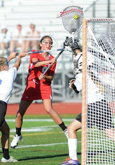 Megan Collins of Greenwich gets her shot stopped by Glastonbury goalie Audrey Apanovitch during the