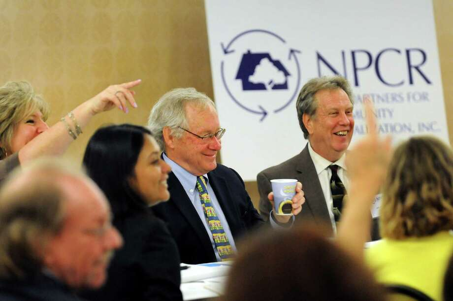 The floor is open to questions for Pete Granis, center, on during the 6th annual NPCR Albany Brownfields Summit on Tuesday, June 4, 2013, at the Holiday Inn Express in Albany, N.Y. Granis, a former DEC Commissioner, spoke about a controversial state tax break program. (Cindy Schultz / Times Union) Photo: Cindy Schultz / 00022547A