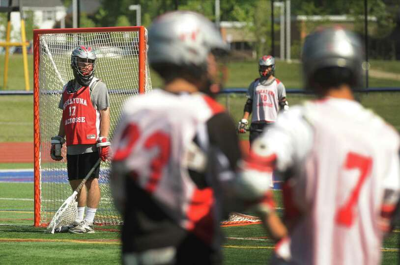Goalie Evan Quinn mans the net as the Niskayuna boys' lacrosse team practices for Wednesday's state