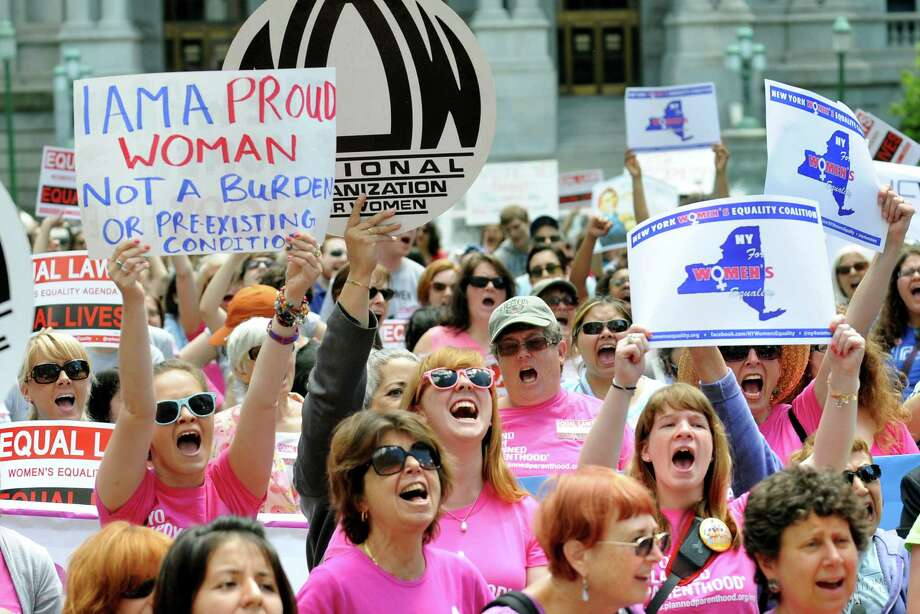 Women from across the state rally in support of the Women's Equality Agenda on Tuesday, June 4, 2013, at West Capitol Park in Albany, N.Y. (Cindy Schultz / Times Union) Photo: Cindy Schultz / 00022650A