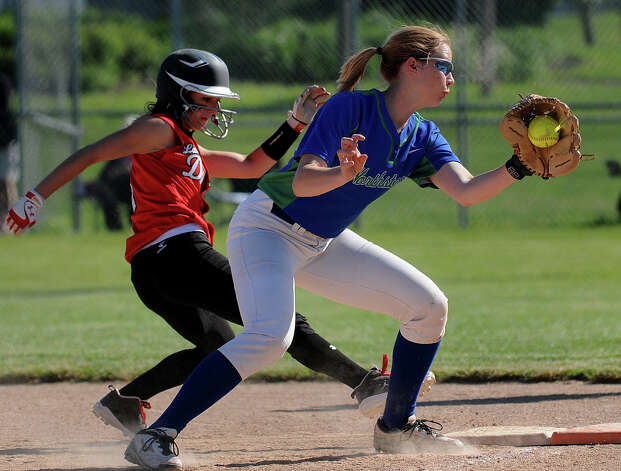 Section III Class AA girls' softball champion Cicero-North Syacuse played Guilderland High School of Section II in an intersectional game on Tuesday, June 4, 2013 at the Gillette Road Softball Complex in North Syracuse. CSN won 7-0. CNS first baseman Morgan Phillips puts a late tag on Guilderland's Tori Greco in the third inning. Stephen D. Cannerelli | scannerelli@syracuse.com Photo: Stephen D. Cannerelli