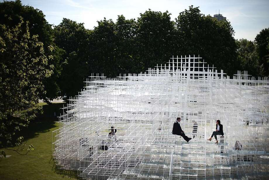 LONDON, ENGLAND - JUNE 04:  Visitors interact with the Serpentine Gallery Pavilion on June 4, 2013 in London, England. Designed by Japanese architect Sou Fujimoto, it occupies 357 square-metres of the lawn in front of the gallery. Using a latticed structure of 20 mm steel poles with a cafe sited inside, visitors are encouraged to enter and interact with the Pavilion in different ways throughout it's month tenure in London's Kensington Gardens.  (Photo by Peter Macdiarmid/Getty Images)  *** BESTPIX *** Photo: Peter Macdiarmid, Getty Images