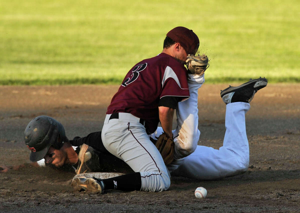 New Canaan's Andrew Casali slides safely into second while colliding with North Haven's Jaycen Torello during their Class L semifinal baseball game at Palmer Field Stadium in Middletown on Tuesday, June 4, 2013. New Canaan won, 5-1.