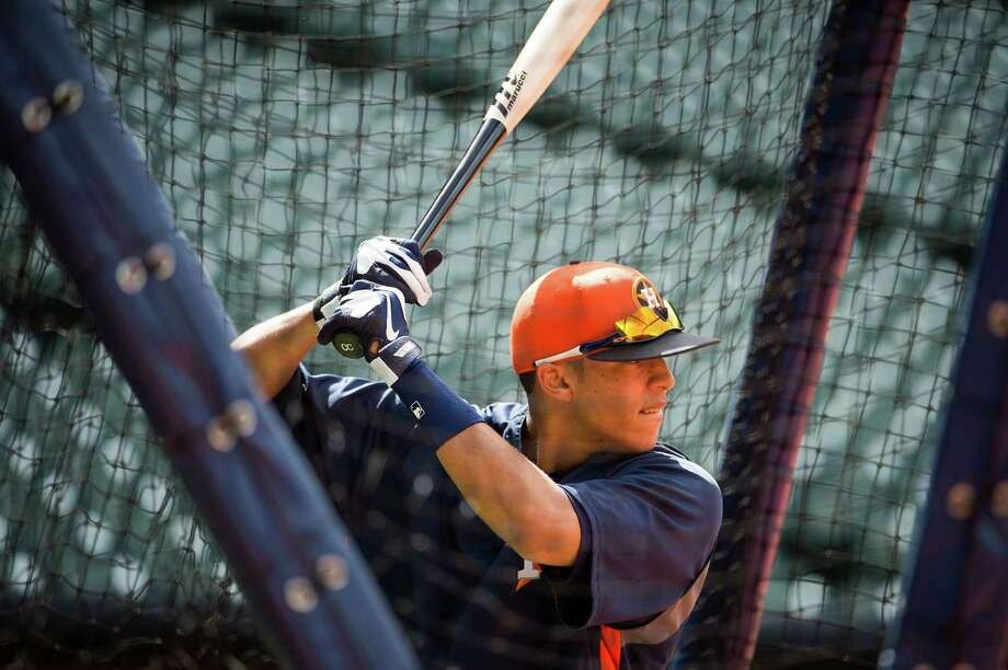 Shortstop prospect Carlos Correa takes batting practice before an exhibition game against the Chicago Cubs at Minute Maid Park on March 29. The next day against the Cubs, Correa went 3-for-4 with an RBI. Photo: Smiley N. Pool / © 2013  Smiley N. Pool