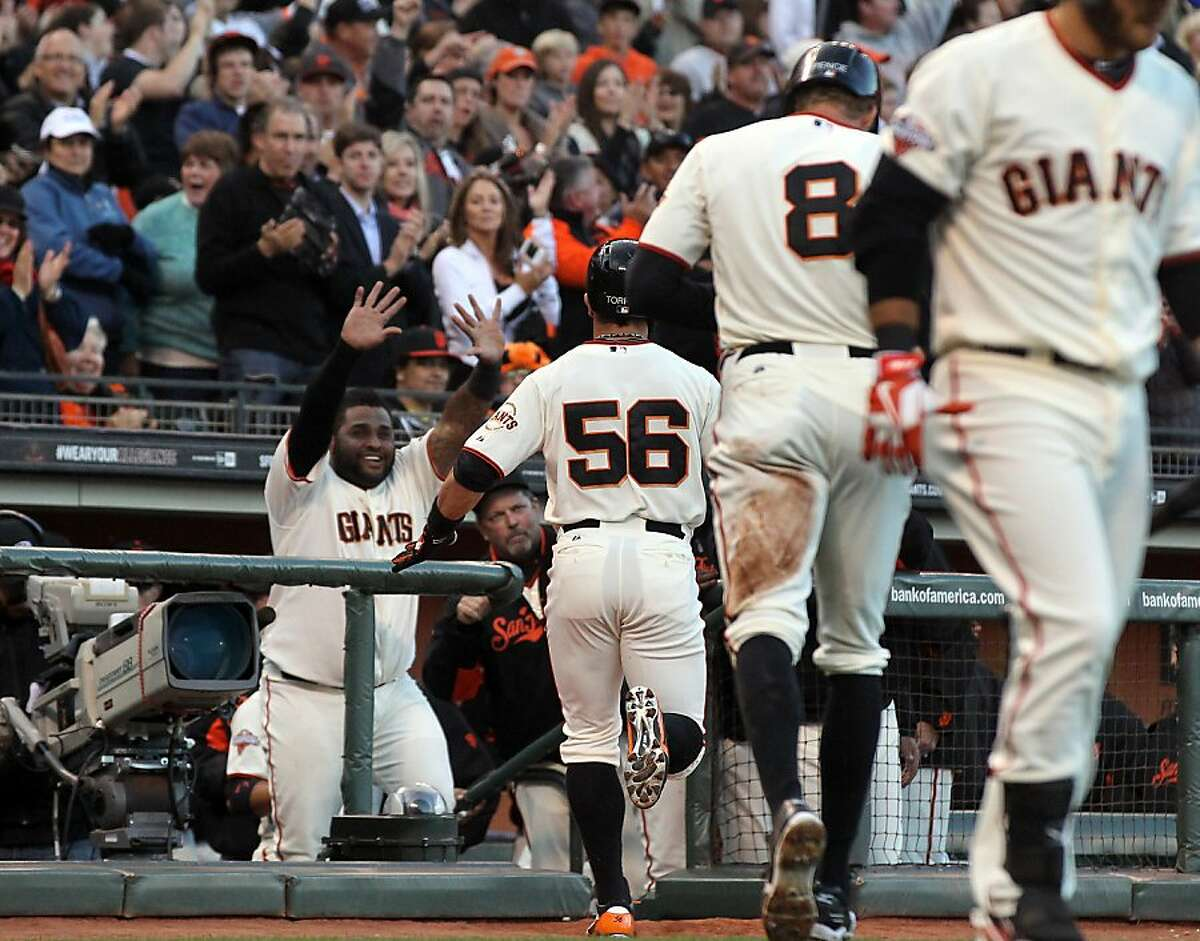 Pablo Sandoval left greets Andres Torres (56) of the San Francisco Giants after his two run homer in the second inning against the Toronto Blue Jays Tuesday, June 4, 2013 in San Francisco Calif.