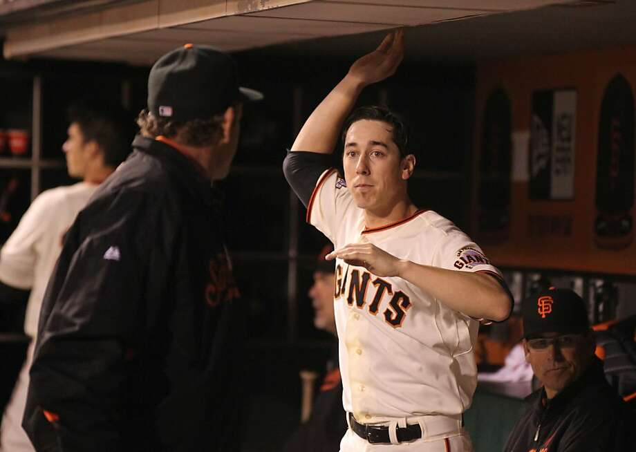 Tim Lincecum listens to Dave Righetti during his June win over Toronto, when he took a new approach. Photo: Lance Iversen, The Chronicle
