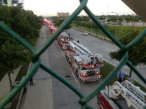 Hundreds of emergency response vehicles arrive for the Fire Fighter memorial service at Reliant Stadium. Photo: James Nielsen/Houston Chronicle Photo: Houston Chronicle