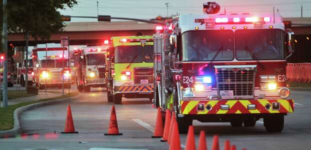 Hundreds of emergency response vehicles arrive for the Fire Fighter memorial service at Reliant Stadium. Photo: Nick de la Torre/Houston Chronicle Photo: Houston Chronicle