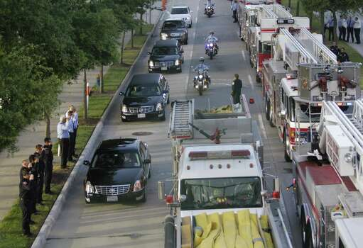 Hearses carrying friends and family arrive for a memorial service honoring four Houston firefighters at Reliant Stadium Wednesday, June 5, 2013. Photo: Houston Chronicle
