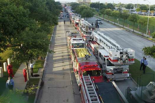 Hundreds of emergency response vehicles arrive for the Fire Fighter memorial service at Reliant Stadium. Photo: Johnny Hanson/Houston Chronicle Photo: Houston Chronicle