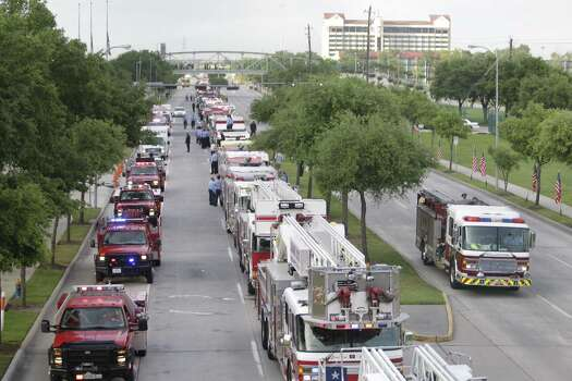 Firetrucks arrive for a memorial service honoring four Houston firefighters at Reliant Stadium Wednesday, June 5, 2013. Photo: Melissa Phillip / Houston Chronicle Photo: Houston Chronicle