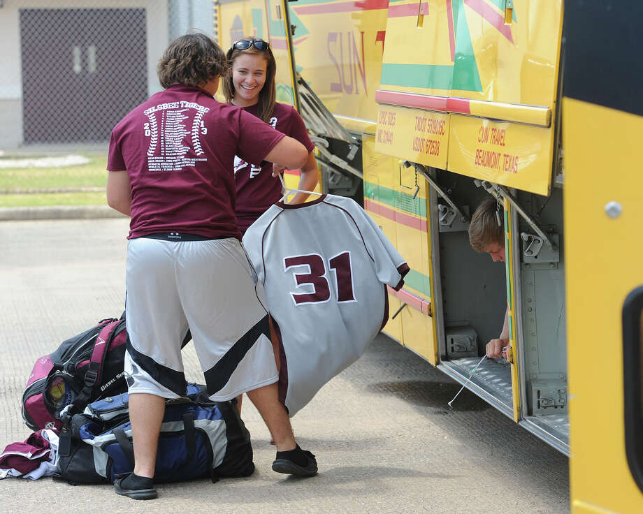 Silsbee's Brayden Griffin loads his equipment on the bus before heading to Austin Tuesday for this week's state finals. The team was sent off around 1 p.m. by the school's students, staff and band. Photo taken Tuesday, June 04, 2013 Guiseppe Barranco/The Enterprise Photo: Guiseppe Barranco, STAFF PHOTOGRAPHER / The Beaumont Enterprise