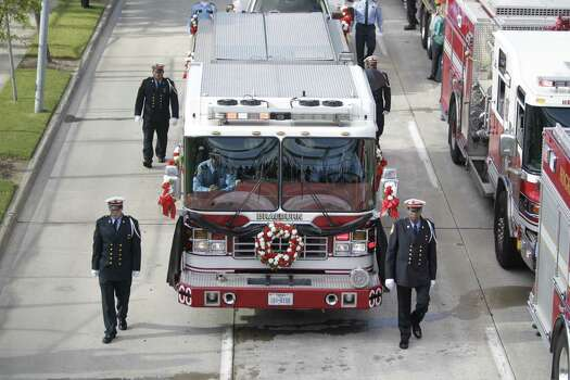 Hundreds of emergency response vehicles arrive for the Fire Fighter memorial service at Reliant Stadium. Photo: Melissa Phillip/Houston Chronicle Photo: Houston Chronicle