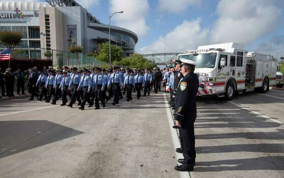 Firefighter's from around Houston and Texas walk during the firefighter's memorial procession Wednesday, June 5, 2013 into Reliant Stadium.  As many as 40,000 people are expected to remember the four firefighters who died Friday, the deadliest day in the Houston Fire Department's 118-year history.   Killed in the fire when the motel structure collapsed were Capt. Matthew Renaud, 35,  engineer operator Robert Bebee, 41,  firefighter Robert Garner, 29, and Anne Sullivan, 24, a probationary firefighter who had graduated in April from the Houston Fire Department Academy.  (AP Photo/Michael Stravato) Photo: MICHAEL STRAVATO, Associated Press / FR29619 AP