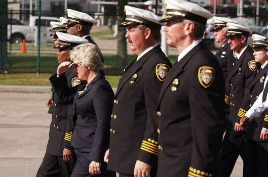 Houston Mayor Annise Parker walks in the Firefighter's memorial procession Wednesday, June 5, 2013. As many as 40,000 people are expected to remember the four firefighters who died Friday, the deadliest day in the Houston Fire Department's 118-year history.   Killed in the fire when the motel structure collapsed were Capt. Matthew Renaud, 35,  engineer operator Robert Bebee, 41,  firefighter Robert Garner, 29, and Anne Sullivan, 24, a probationary firefighter who had graduated in April from the Houston Fire Department Academy. (AP Photo / Michael Stravato) Photo: Michael Stravato, Associated Press / FR29619 AP