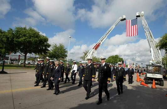 Houston Mayor Annise Parker walks in the Firefighter's memorial procession Wednesday, June 5, 2013 in Houston. As many as 40,000 people are expected to remember the four firefighters who died Friday, the deadliest day in the Houston Fire Department's 118-year history.   Killed in the fire when the motel structure collapsed were Capt. Matthew Renaud, 35,  engineer operator Robert Bebee, 41,  firefighter Robert Garner, 29, and Anne Sullivan, 24, a probationary firefighter who had graduated in April from the Houston Fire Department Academy. (AP Photo/Michael Stravato) Photo: MICHAEL STRAVATO, Associated Press / FR29619 AP