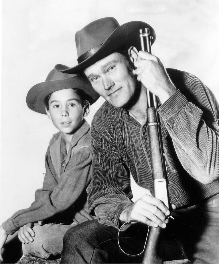 """Show:The RiflemanDad: Lucas McCain (Chuck Connors)Fatherly advice: """"Sometimes when people don't understand something, they think it's to be  feared or hated. That's wrong, but it takes a long time to learn  differently."""" Photo: ABC Photo Archives, ABC Via Getty Images / American Broadcasting Companies, Inc."""