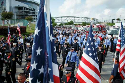 Emergency personnel take part in a memorial service honoring four Houston firefighters at Reliant Stadium Wednesday, June 5, 2013. In Houston. Four firefighters died when a part of a building collapsed on them while they were searching for people they thought might be trapped inside a burning motel and restaurant last Friday. Photo: Michael Paulsen, Houston Chronicle / © 2013 Houston Chronicle