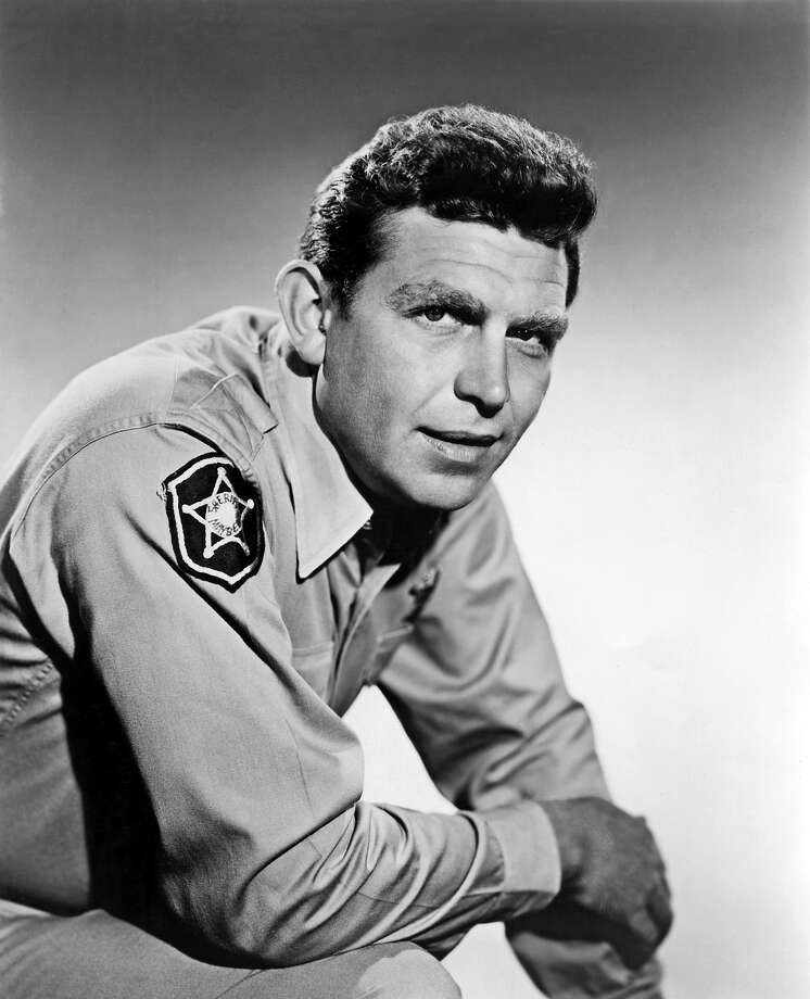 """Show:The Andy Griffith ShowDad: Sheriff Andy Taylor (Andy Griffith)Fatherly advice: """"When a man carries a gun all the time, the respect he thinks he's  getting might really be fear. So I don't carry a gun because I don't  want the people of Mayberry to fear a gun. I'd rather they respect me."""" Photo: Michael Ochs Archives, Getty Images / Michael Ochs Archives"""