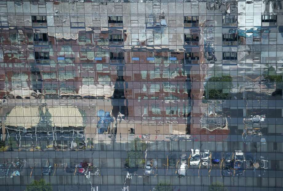 BUFFALO, NY - JUNE 04:  A city street is reflected in an office building on June 4, 2013 in Buffalo, New York, near the U.S.-Canada border. The aerial view was seen from a helicopter flown by the U.S. Office of Air and Marine, (OAM), which monitors and patrols the U.S.-Canada border. Photo: John Moore, Getty Images / 2013 Getty Images