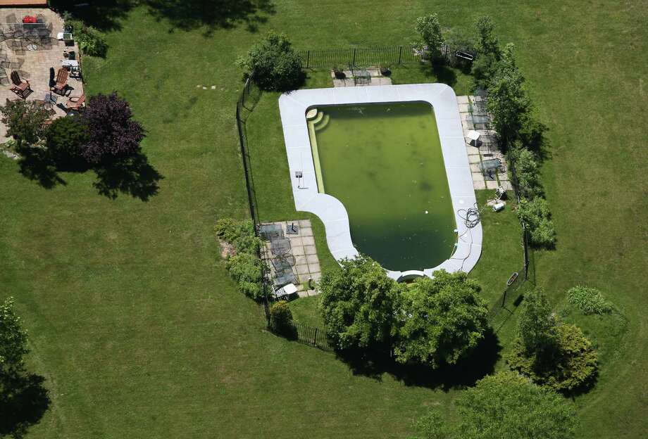 BUFFALO, NY - JUNE 04:  A swimming pool lies unprepared for summer on June 4, 2013 in Buffalo, New York, near the U.S.-Canada border. The aerial view was seen from a helicopter flown by the U.S. Office of Air and Marine, (OAM), which monitors and patrols the U.S. Canada border. Photo: John Moore, Getty Images / 2013 Getty Images
