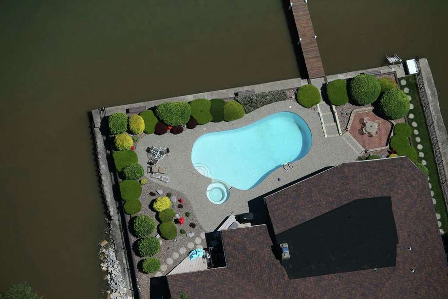 GRAND ISLAND, NY - JUNE 04:  A swimming pool lies ready for summer along the Niagara River on June 4, 2013 near Grand Island, New York, along the U.S.-Canada border. The aerial view was seen from a helicopter flown by the U.S. Office of Air and Marine, (OAM), which monitors and patrols the U.S.-Canada border. Photo: John Moore, Getty Images / 2013 Getty Images