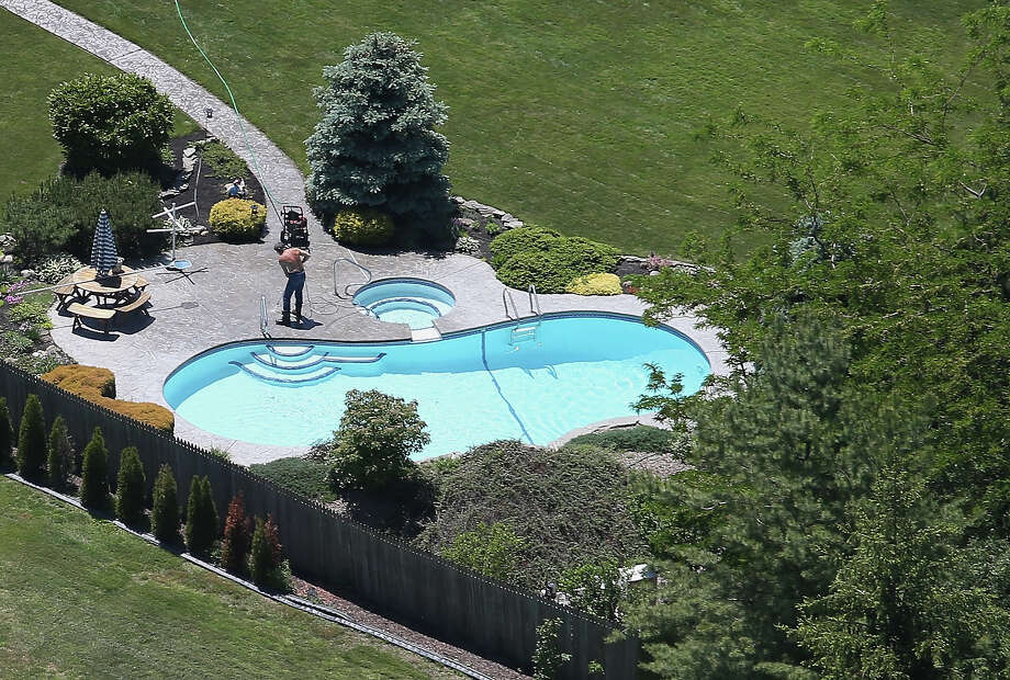 GRAND ISLAND, NY - JUNE 04:  A swimming pool is prepared for summer along the Niagara River on June 4, 2013 near Grand Island, New York, along the U.S.-Canada border. The aerial view was seen from a helicopter flown by the U.S. Office of Air and Marine, (OAM), which monitors and patrols the U.S.-Canada border. Photo: John Moore, Getty Images / 2013 Getty Images