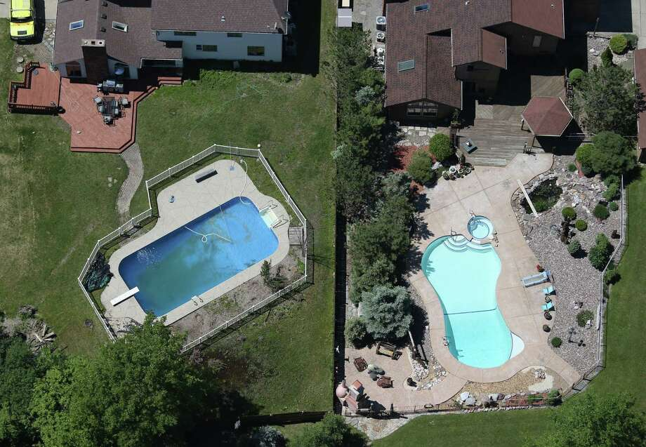 BUFFALO, NY - JUNE 04:  Swimming pools lie in varied stages of preparation for summer on June 4, 2013 in Buffalo, New York, near the U.S.-Canada border. The aerial view was seen from a helicopter flown by the U.S. Office of Air and Marine, (OAM), which monitors and patrols the U.S. Canada border. Photo: John Moore, Getty Images / 2013 Getty Images