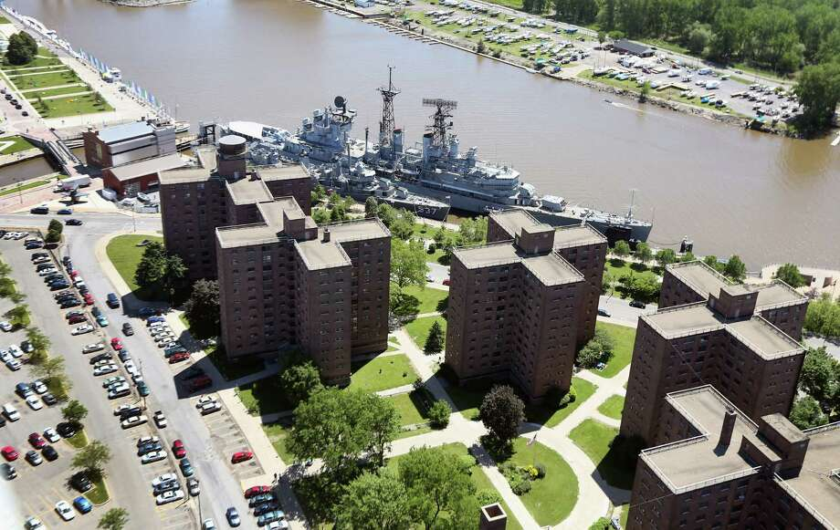 BUFFALO, NY - JUNE 04:  The Buffalo and Erie County Naval and Military Park stradles a housing project on June 4, 2013 in Buffalo, New York, near the U.S.-Canada border. The aerial view was seen from a helicopter flown by the U.S. Office of Air and Marine, (OAM), which monitors and patrols the U.S.-Canada border. Photo: John Moore, Getty Images / 2013 Getty Images
