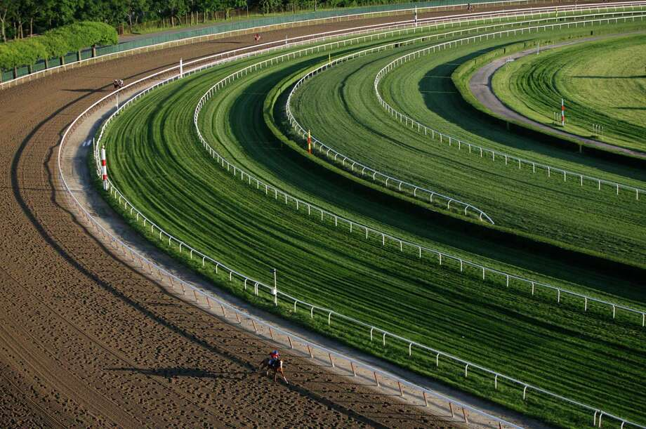 A horse gallops around the fourth turn of the 1 1/2 mile track during a morning workout at Belmont Park, Wednesday, June 5, 2013 in Elmont, N.Y. The Belmont Stakes horse race is Saturday. Photo: Mark Lennihan, AP / AP