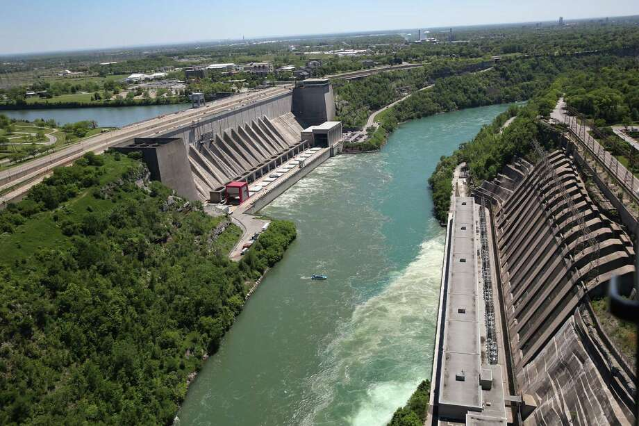 LEWISTON, NY - JUNE 04:  Water from the Niagara River passes through a hydroelectric dam the Robert Moses Generating Facility on June 4, 2013 at Lewiston, New York. When the power plant went online in 1961 it was the biggest hydroelectric producer in the Western world and is still the main source of electricity for the State of New York. The aerial view was seen from a helicopter flown by the U.S. Office of Air and Marine, (OAM), which monitors and patrols the U.S. northern border with Canana. Photo: John Moore, Getty Images / 2013 Getty Images