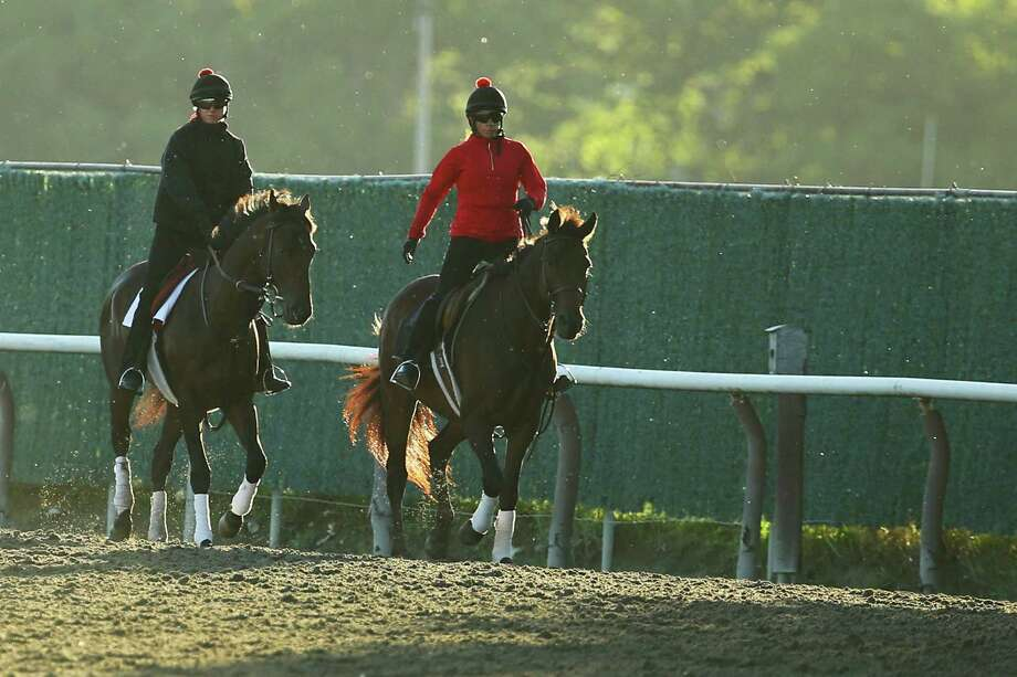 ELMONT, NY - JUNE 04:  Exercise rider Jennifer Patterson aboard Kentucky Derby winner Orb (L) walks off the track with trainer Shug McGaughey (R) following a light workout on the track at Belmont Park on June 4, 2013 in Elmont, New York. Photo: Al Bello, Getty Images / 2013 Getty Images